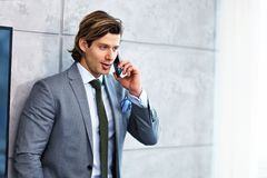 Close up portrait of businessman talking on phone at workplace royalty free stock photos