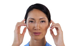 Close up portrait of businesswoman adjusting invisible eyeglasses Royalty Free Stock Image