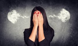 Close-up portrait of businesswoman hiding face in Stock Image