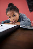Close up portrait of businesswoman leaning on desk Stock Photo