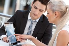 Businesswoman showing work to partner. Royalty Free Stock Photography