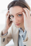 Close up portrait of businesswoman suffering from headache Stock Image