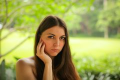 Close up portrait of carefree caucasian young woman posing with different emotions in green summer park stock photo