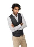 Close up portrait of a casual business man. Standing on isolated whet background with arms crossed Royalty Free Stock Image