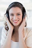 Close up portrait of casual woman enjoying music Stock Photography