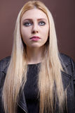 Close up portrait of a caucasian girl wearing a leather jacket Royalty Free Stock Images