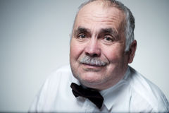 Close-up portrait of a Caucasian senior man with mustache Royalty Free Stock Photos