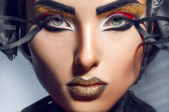 Close up portrait of charming adult woman with gold lips Stock Photos