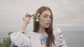 Portrait adorable carefree girl wearing long summer fashion dress looking confident at camera enjoying. Leisure and. Close-up portrait charming carefree girl stock video