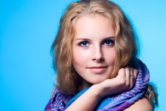 Close-up portrait of a charming girl with a scarf Royalty Free Stock Photo