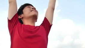 Close up portrait of cheerful asian boy smiling happy playful enjoying day stock video footage