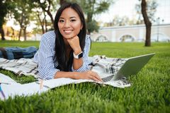 Close-up portrait of cheerful asian student, looking at camera, Stock Photo