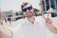 Close up portrait of cheerful handsome delightful excited glad j. Oyful with toothy beaming smile modern trendy style stylish hairdo hairstyle virile macho stock images