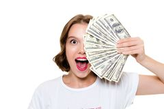 Close up portrait of a cheerful happy girl. Holding bunch of money banknotes at her face and looking at camera isolated over white background Royalty Free Stock Image