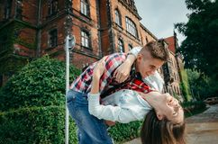 Close-up portrait of the cheerful loving couple dancing in the green street of Poland. Stock Image