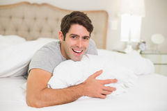 Close up portrait of a cheerful man resting in bed Stock Photography