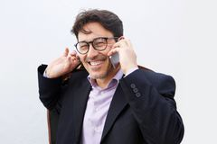 Cheerful middle aged businessman with glasses talking on mobile phone. Close up portrait of cheerful middle aged businessman with glasses talking on mobile phone Royalty Free Stock Photo