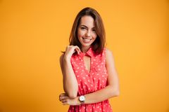 Close-up portrait of cheerful stylish brunette woman loking at c Royalty Free Stock Image