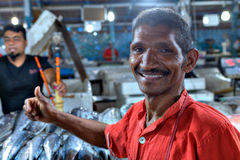 Close-up portrait of a cheerful worker at a fish market. Royalty Free Stock Photography