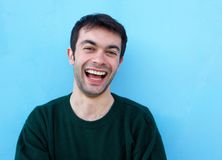 Close up portrait of a cheerful young man laughing Stock Images