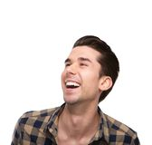 Close up portrait of a cheerful young man laughing Stock Image