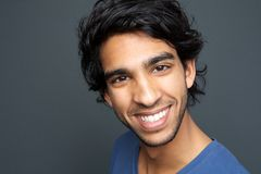 Close up portrait of a cheerful young man smiling Stock Photos