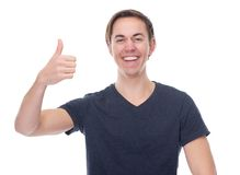 Close up portrait cheerful young man with thumbs up Stock Photos
