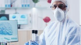 Close up portrait of chemist researcher in high security laboratory. Close up portrait of chemist researcher looking at the camera in high security laboratory stock footage
