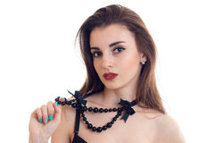 Close-up portrait of a chic young Brunettes with a necklace around his neck and red lipstick Stock Photography
