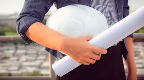 Close up portrait of civil engineer woman hand holding hardhat a royalty free stock photo