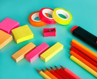 Colorful office stationary on pastel background. Close up portrait of colorful office stationary on pastel background Stock Photography