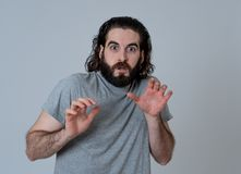 Close up portrait of concern shocked young man with frightened gestures. Scared facial expression stock photo