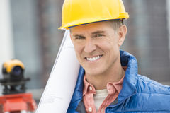 Close-Up Portrait Of Confident With Blueprint Royalty Free Stock Image