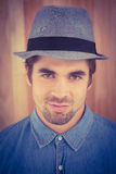 Close-up portrait of confident hipster wearing hat Royalty Free Stock Image