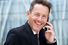 Close up confident older businessman talking on mobile phone Royalty Free Stock Photos