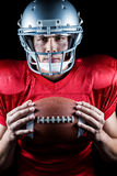 Close-up portrait of confident sportsman holding American football Royalty Free Stock Photography