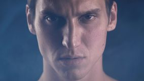 Close-up portrait. Confident strong man looking at camera. Athlete serious focused look champion. Close up portrait. Confident strong man looking at camera stock video