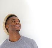 Close up portrait of a cool guy laughing with hat Stock Photos