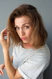 Close up portrait of a cool mid adult woman. Posing on gray background Stock Photography