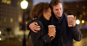 Close up portrait of couple drinking coffee at night Royalty Free Stock Photos