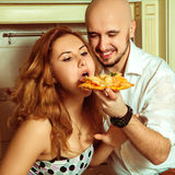 Close up portrait of couple having fun with pizza Royalty Free Stock Photo
