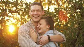 Close up portrait of couple hugging, laughing and smiling outdoors in nature on holiday vacation honeymoon stock footage