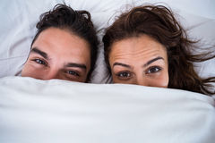 Close-up portrait of couple relaxing on bed. At home Royalty Free Stock Photography