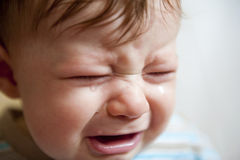 Close-up portrait of a crying baby boy Royalty Free Stock Images