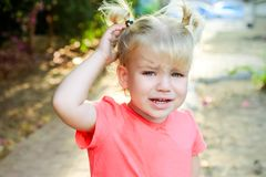 Close up portrait of crying little toddler girl with outdoors background. Child feelings and emothions concept. Seelctive focus, c. Opy space royalty free stock images
