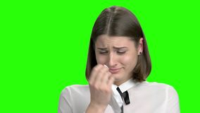 Close up portrait of crying teen student girl. Green screen hromakey background for keying stock video