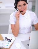 Close-up portrait of a customer service agent sitting at office Royalty Free Stock Photos