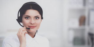 Close-up portrait of a customer service agent sitting at office Stock Images