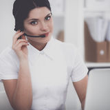 Close-up portrait of a customer service agent sitting at office Stock Image