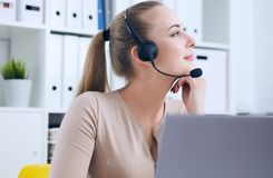 Close-up portrait of a customer service agent sitting at office propped her head by hand and dreaming. stock photos